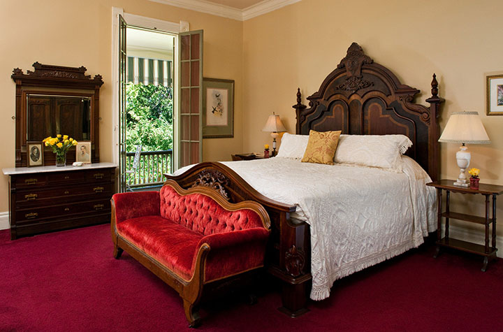 Comfortable guest room at Devereaux Shields House