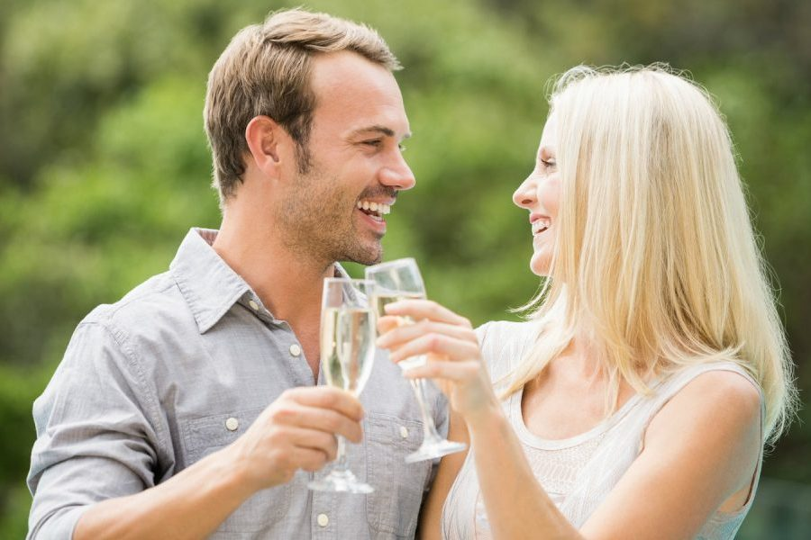 Couple toasting champagne on an anniversary getaway in MS