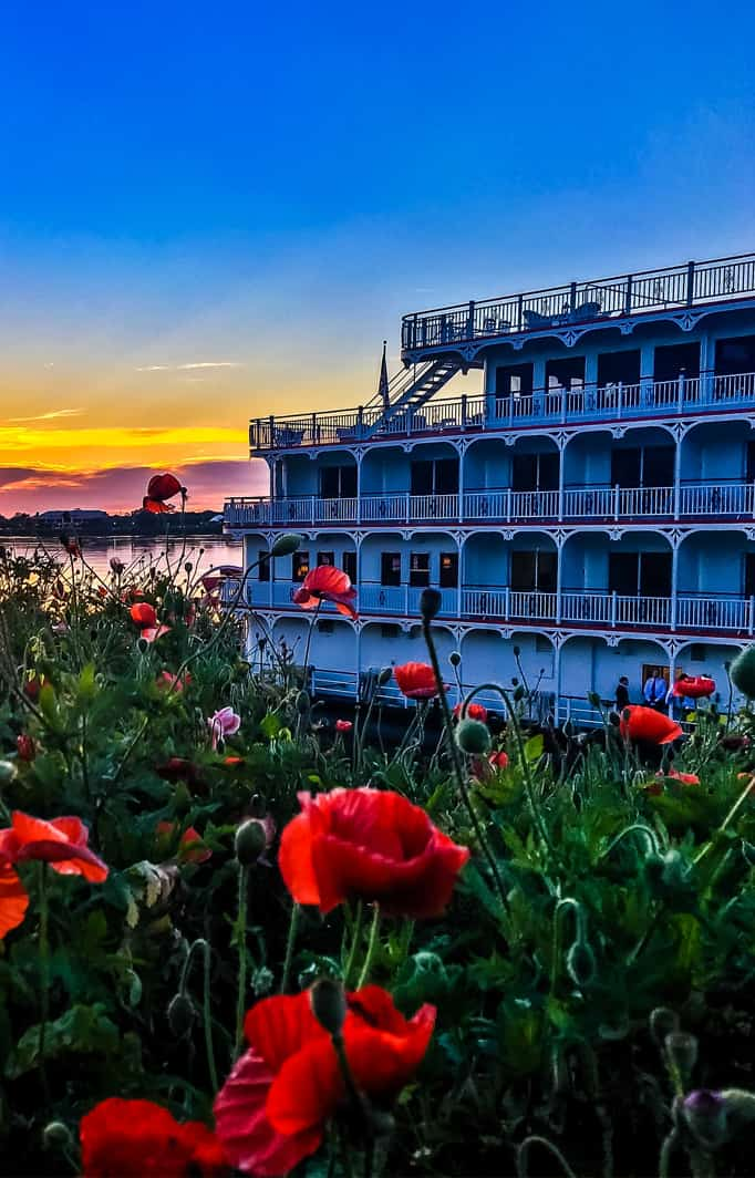 riverboat at sunset on Mississippi River in Natchez with poppies