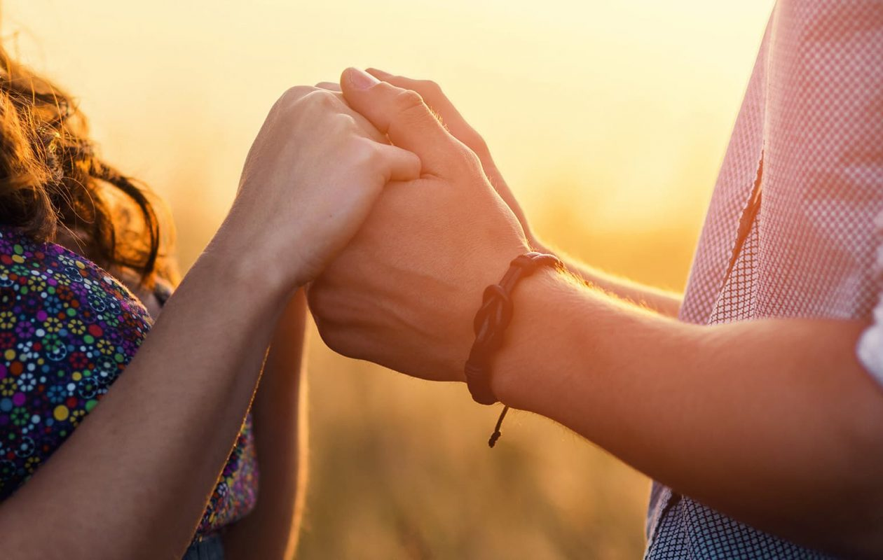 romantic couple holding hands on a date