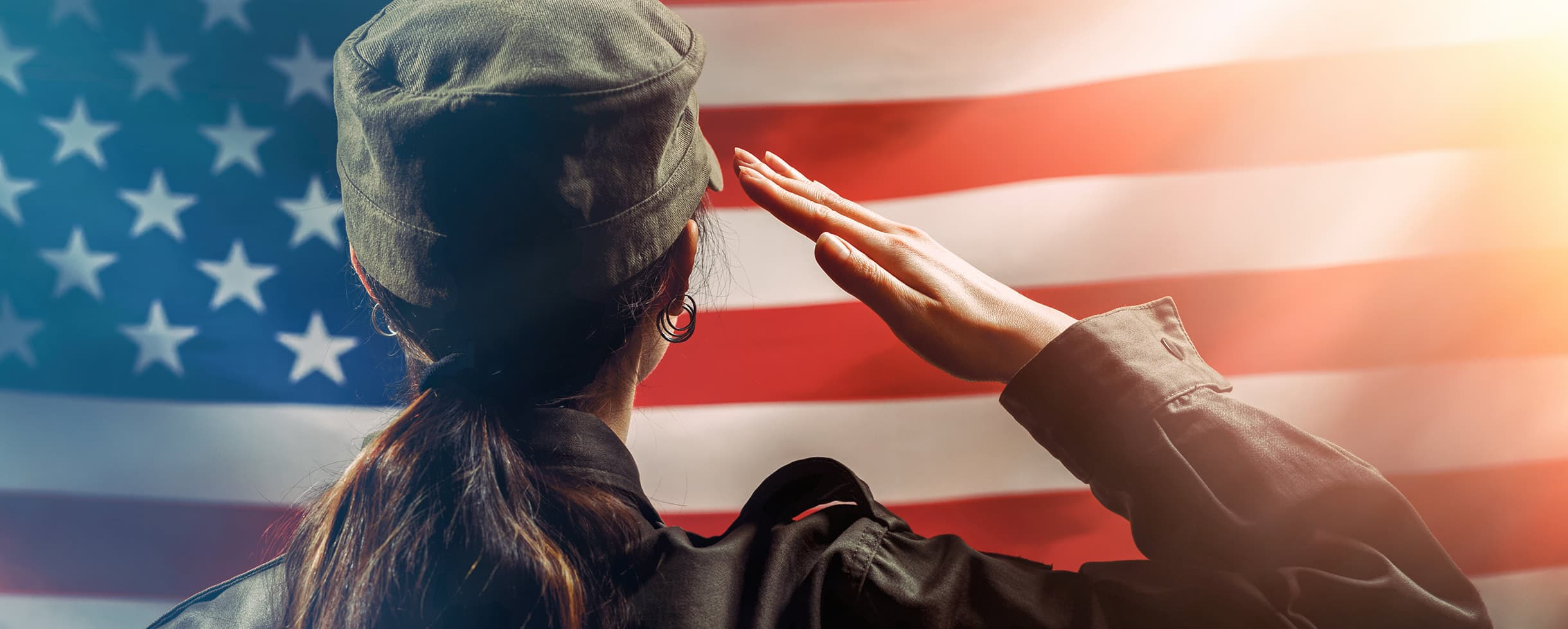 female soldier salutes the American flag