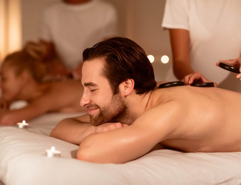 couple getting a hot stone massage