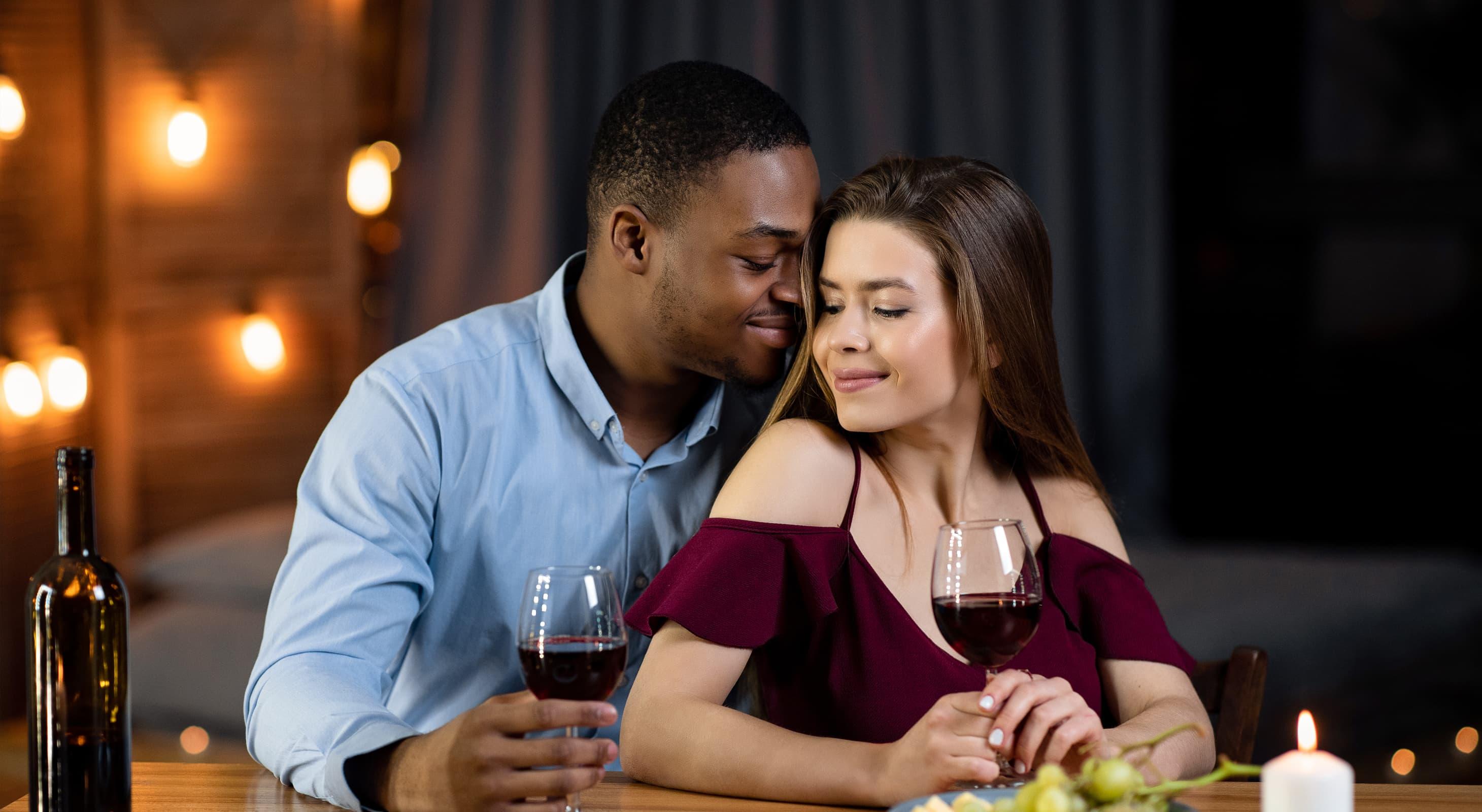 man an woman at romantic dinner
